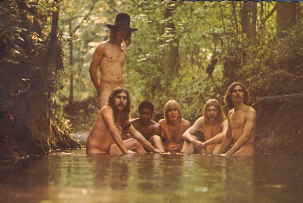 The Allman Brothers, hanging out in a stream. Literally, hanging out.
