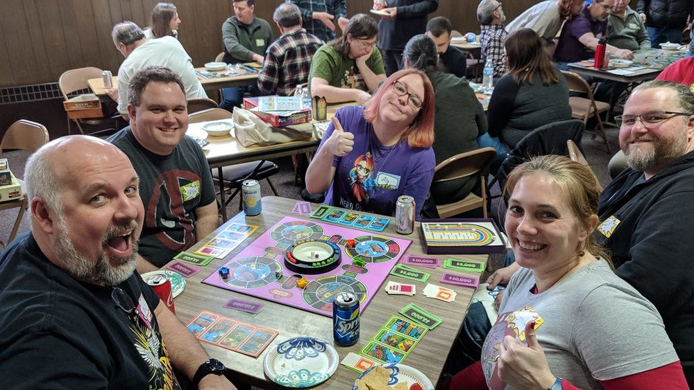 Carl and Alli Gannon joined Jon and Emily Detmer and their friend to play a game of The Magnificent Race. Carl introduced to me to it at his Kitchcon earlier this summer, and I played with the Detmers not long after that when I got my own copy.