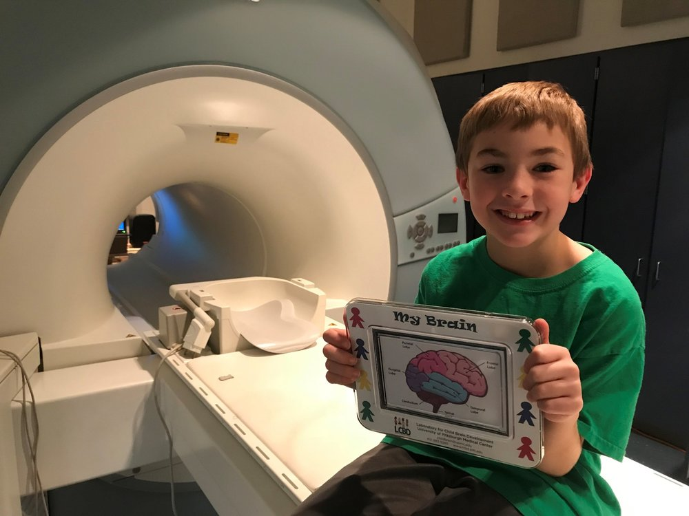 - We will send you home with a picture of your brain in a frame, a visa gift card and a special prize.You will also be helping the researchers in our lab better understand how the brain works so we can help other kids!You will get plenty of practice before you go into the real scanner. The researchers will practice the different games that you will play along with the sounds that you will hear in the real scanner.We will practice the statue game in the mock scanner because it is very important to stay very still. We want you to be able to take home a clear picture of your brain to show your friends and family.It is also very important that you wear comfy clothes to the visit such as a sweatshirt and sweat pants. You cannot have any metal on your clothes.If you want you are welcome to bring a stuffed animal or blanket from home for comfort. Our techs will make sure it is safe to come into the scanner with you.You can get ready for the scan at home by practicing the statue game. Simply lay on the floor and have your mom or dad time how long you can stay still.