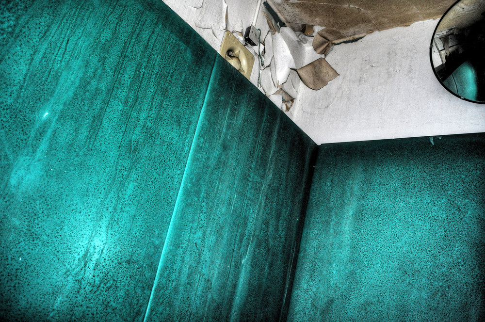 Harpersbury Asylum - North London mental hospital.One of the last remaining padded cells, this one a lurid green.It was sweaty and moist, hidden in the darkness and so looked pretty striking in the torch light. Spent a few moment alone in there in the silence and dark imagining the things that had happened there in the past.