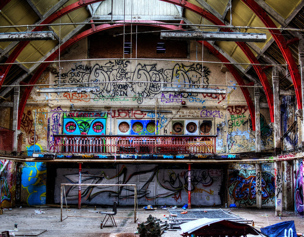Ladywell Baths - An Old Public Swimming Hall - Big room, funked up up with some very bright graf. Not much else to be honestLooks like the kids have so much fun in here-Beer cans and paint cans mixed up, empty sudafed packets and a make-shift football court. Very striking colours.
