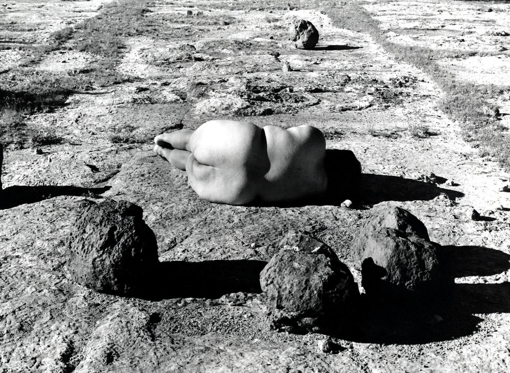 """Laura Aguilar's """"Nature Self-Portrait #2,"""" 1996, gelatin silver print, 16 inches by 20 inches. Laura Aguilar / UCLA Chicano Studies Research Center"""