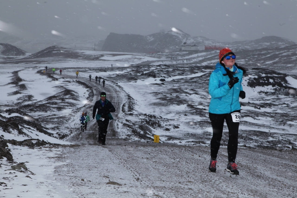 woman running marathon antarctica snow