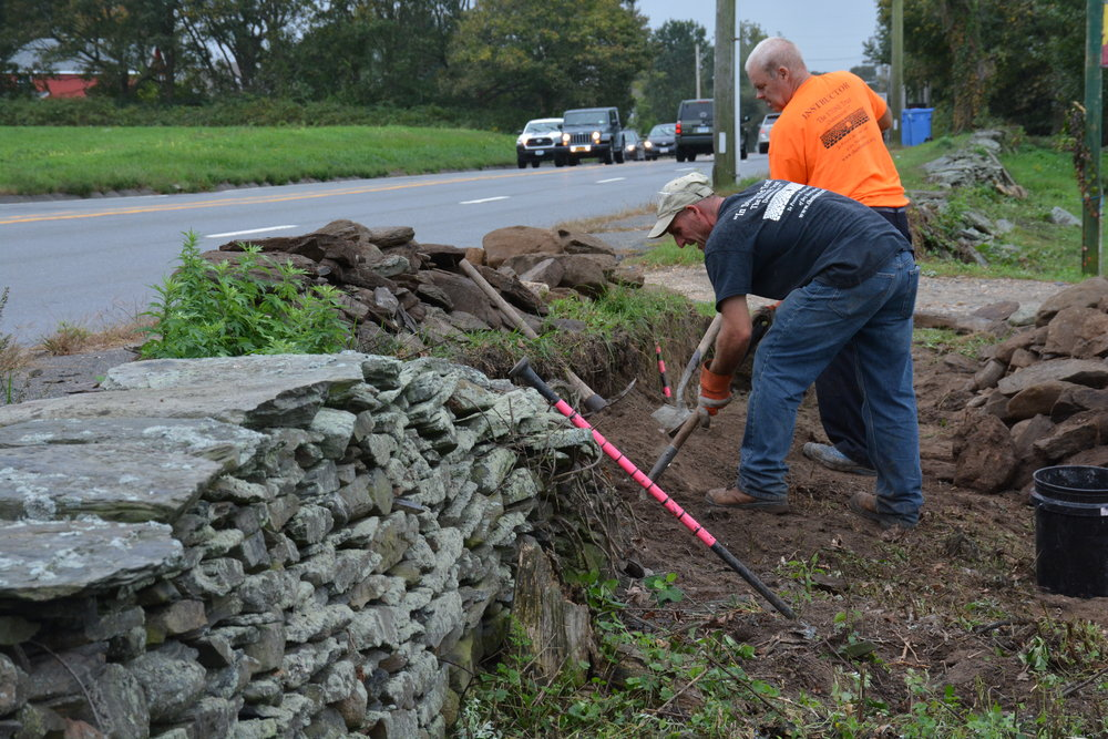 Masons Robert Faraone and Michael Murphy repairing an historic retaining wall at  Simmons Farm  in Middletown.