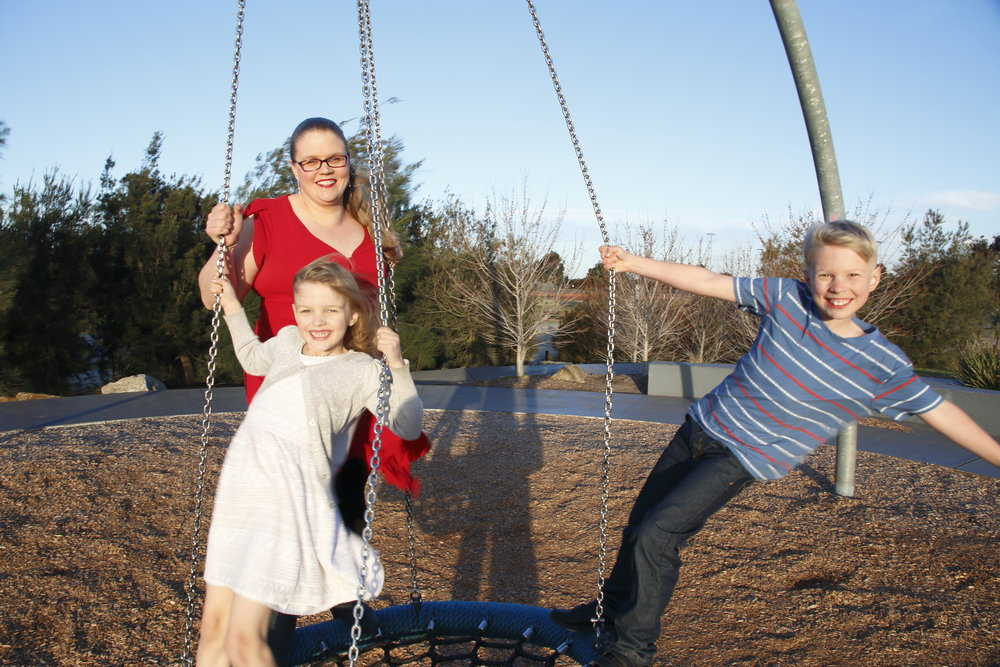 Carmen winning and swinging with her kids