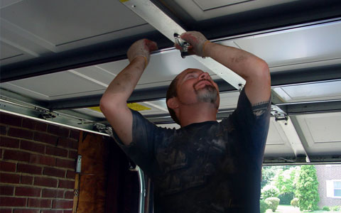 Repairs - We specialize in gutter and garage door repairs.