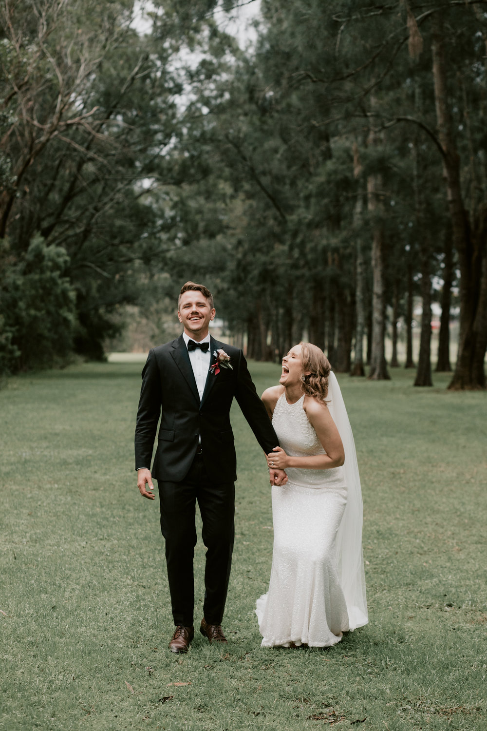 laughing bride and groom with samuel jacob wedding photographer in central coast outside newcastle hunter valley