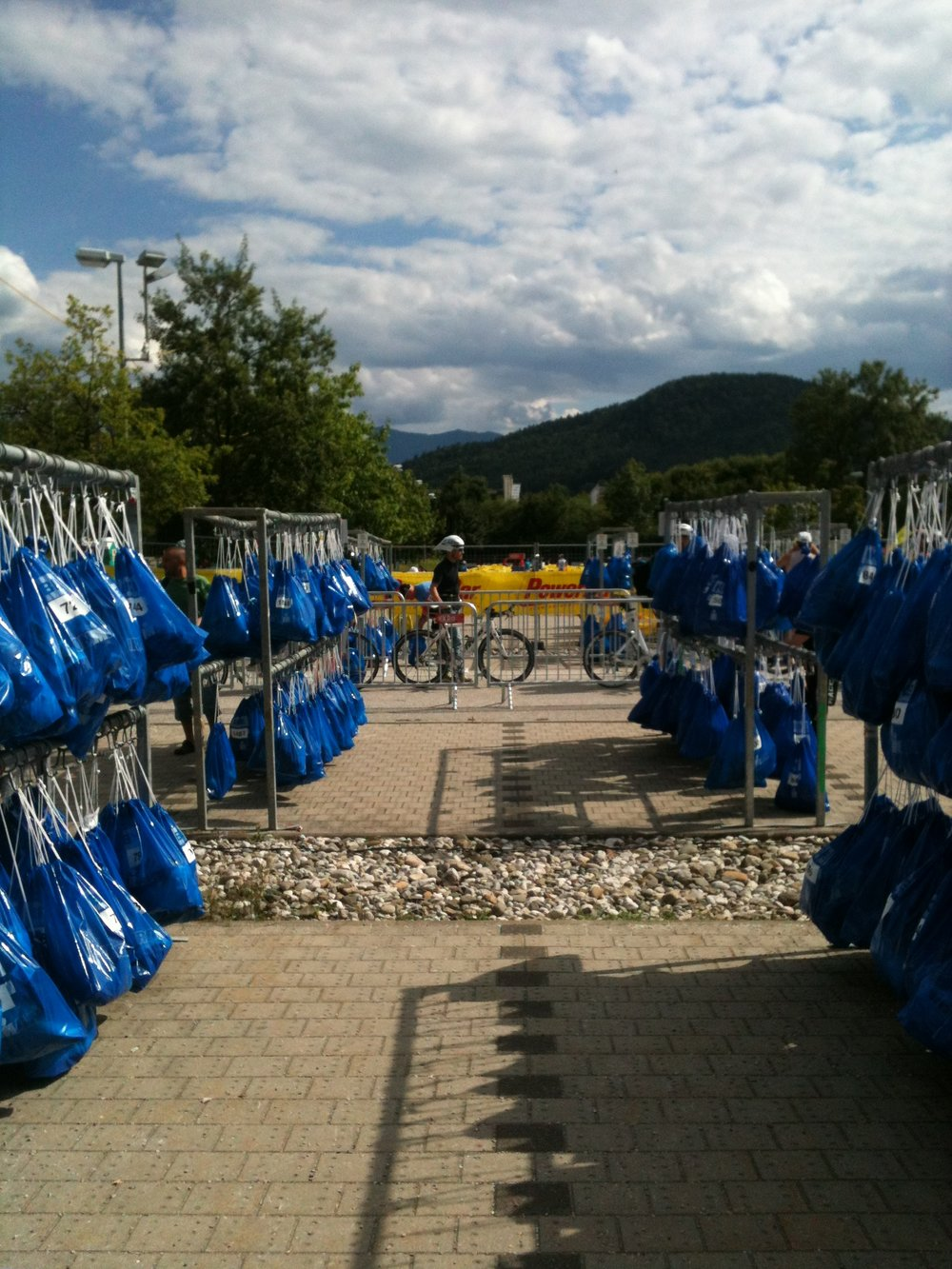 Blue bike bags lined up in T2