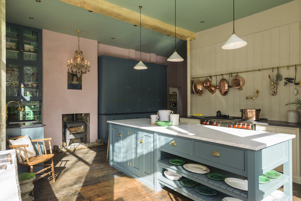 I absolutely love  Devol Kitchens  and this one is probably my favourite. The kitchen cabinets might be a fairly neutral blue but the green tiles and pink wall make this such a happy colourful place.