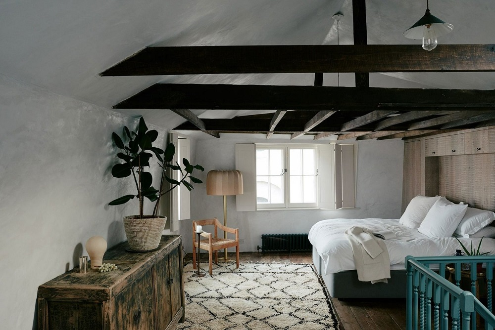 A serene attic bedroom in The Weavers House in London   photo by Michael Sinclair