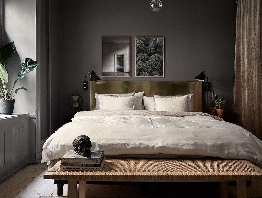 Grey bedroom with golden headboard