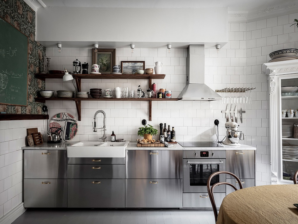 Modern stainless steel kitchen with vintage touches   photo by Anders Bergstedt