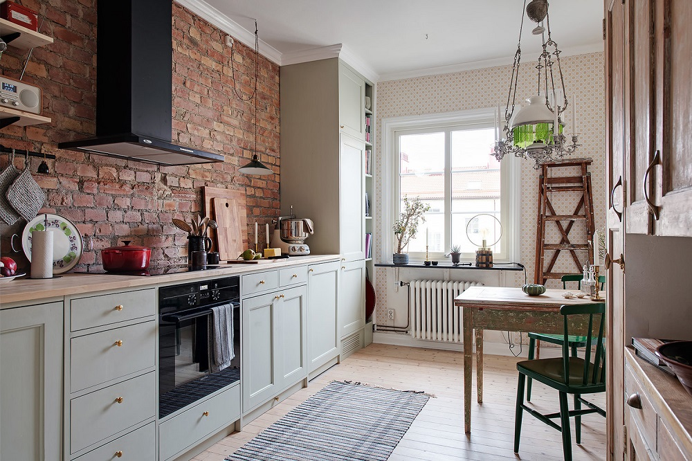 Exposed brick in a vintage looking kitchen   photo by Fredrik J Karlsson