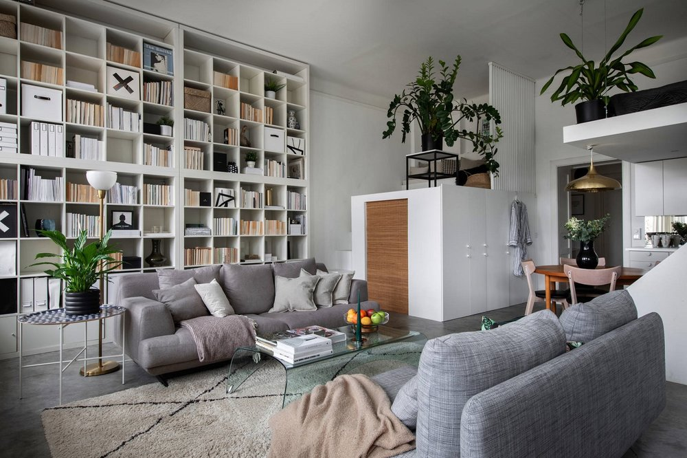 The Nordroom - A Small Scandinavian Loft Looks Spacious Thanks To A Mirrored Wall