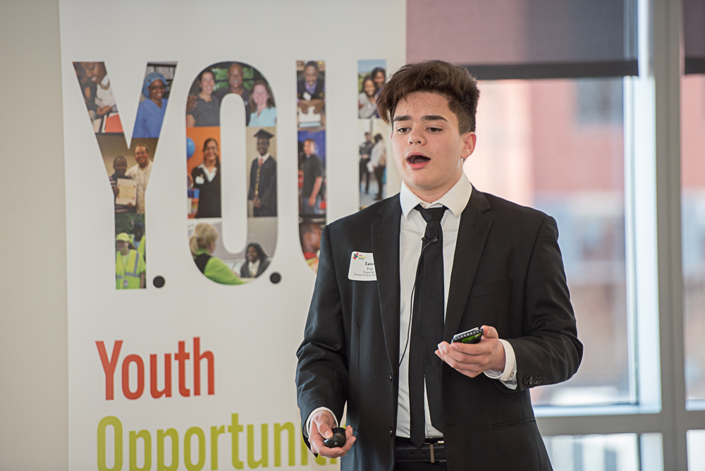 Youth-competetor-speaking-in-front-of-banner.jpg