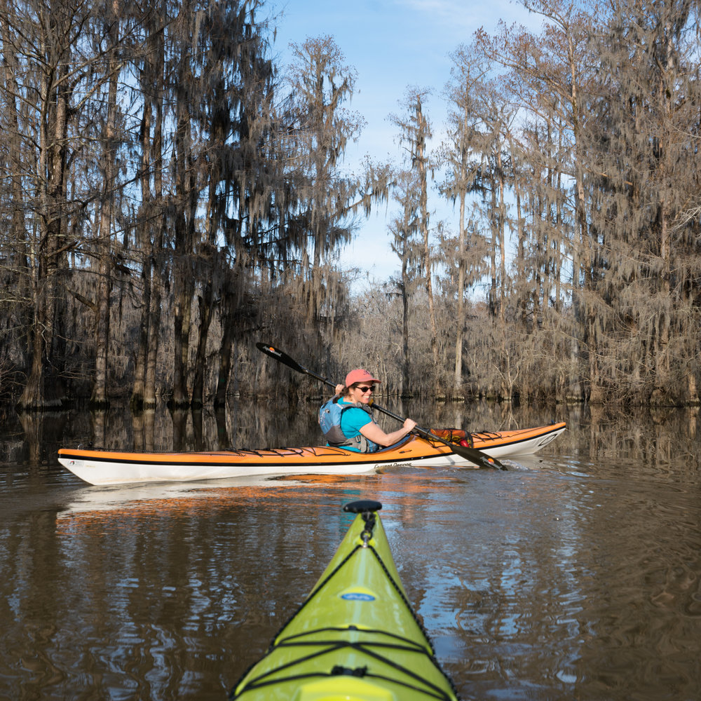 Salwa in her Current Designs Suka Kayak with a backdrop of spanish moss