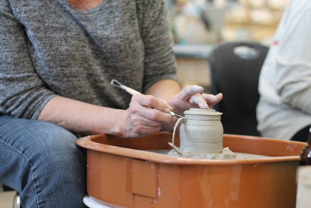 pottery student trimming 4.JPG