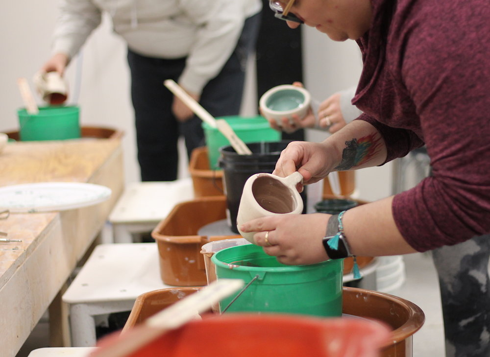 Art Lab - Pottery students glazing.JPG