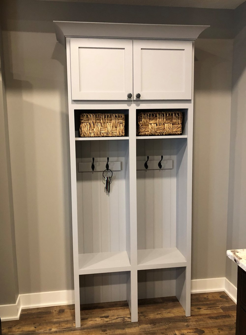Lockers - StarMark Cabinetry - Bedford door style in Maple finished with Frost tinted varnish