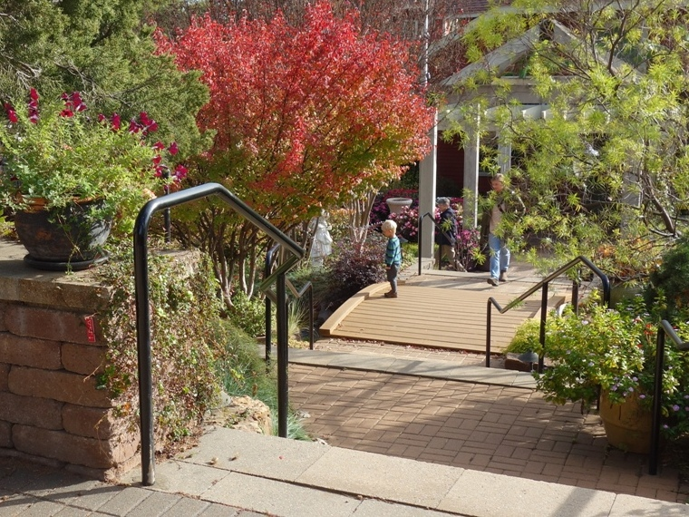 From here, descend toward the Visitor's Center and Greenhouse via the stairs to the right.