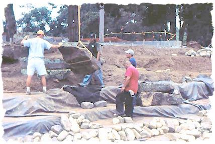 Placing a large boulder.
