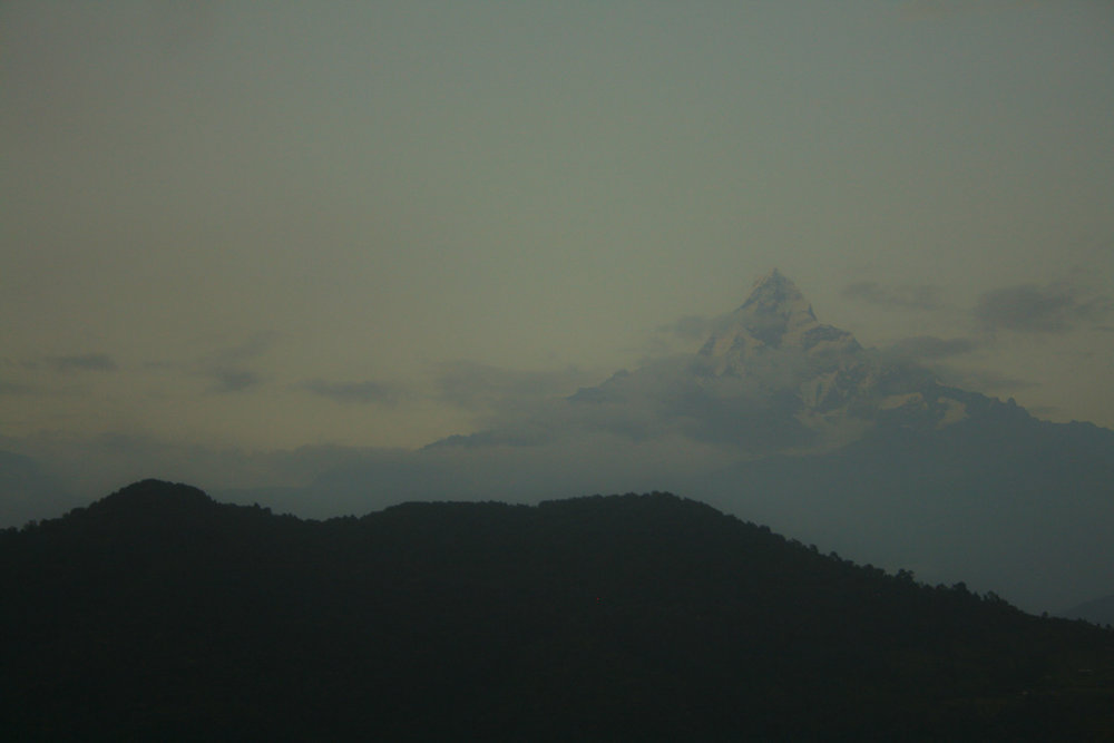 At the peak of the hike, we walked an hour and a half at 4:30 am to the top of Poon Hill. Amusingly, there was a Chai shop at the top as well. The hill was flooded with tourists, and anticipation grew as the sun-rise grew closer.