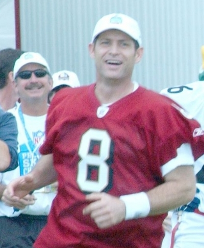 By Lance Cpl. Ethan Hoaldridge: Steve Young, Feb 10, 2006  Public Domain   https://commons.wikimedia.org/wiki/File:Steve_Young_and_Michael_Irvin.jpg
