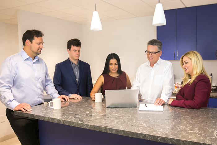Bessolo Haworth team at work in the Sherman Oaks office. Links to About Us page.
