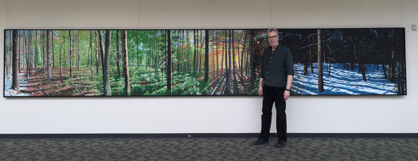 Charlie Yoder in front of his acrylic and oil painting,  Four Play , 2016, 4' x 24'