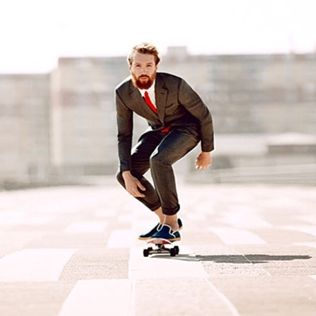 True Gentleman Skateboarding in suit