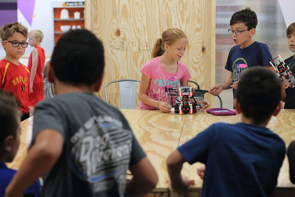 Traveling Lab - Robotics Camp girl with robot.JPG