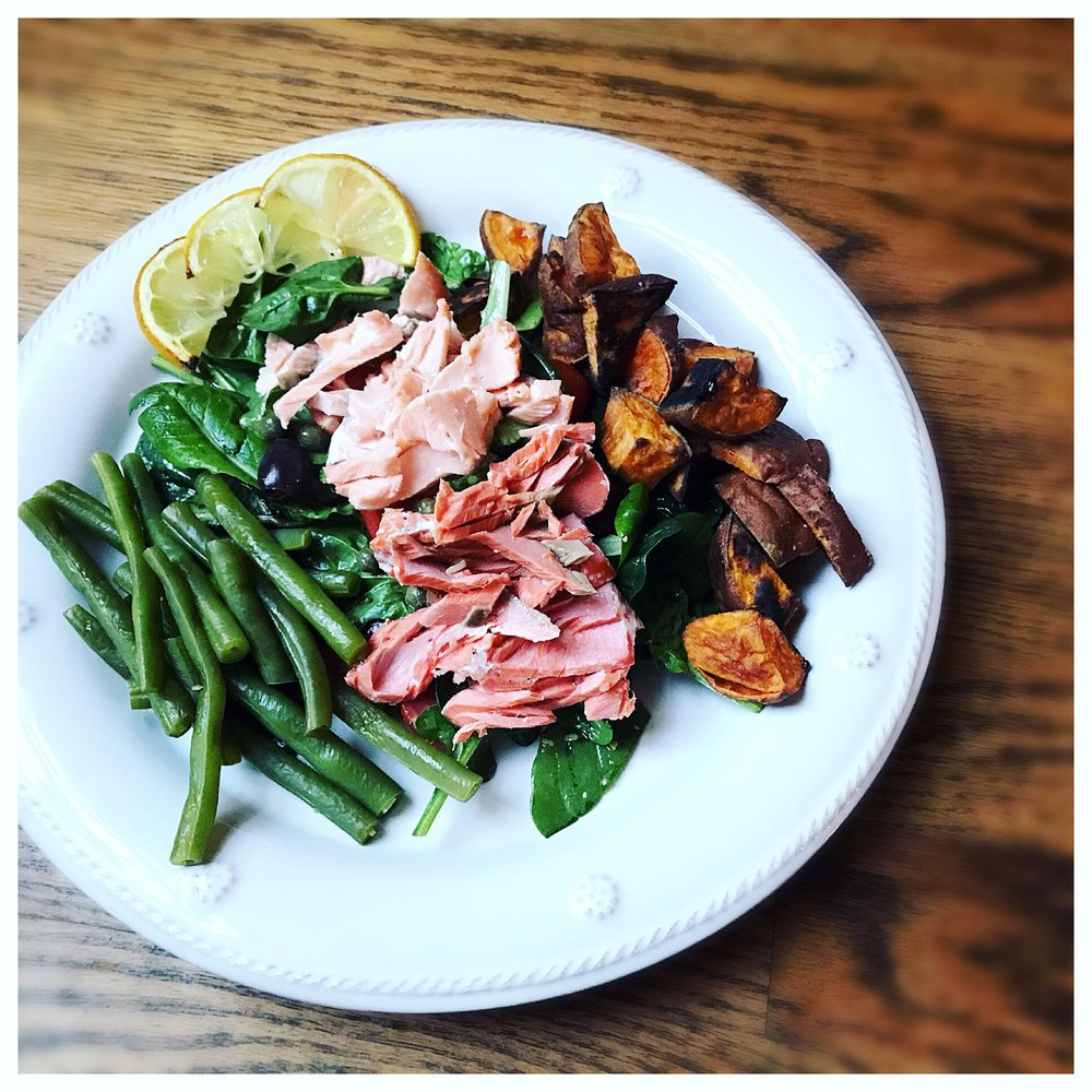 Layer roasted sweet potatoes, steamed green beans & flaked salmon to dish. Serve with the roasted lemon slices.