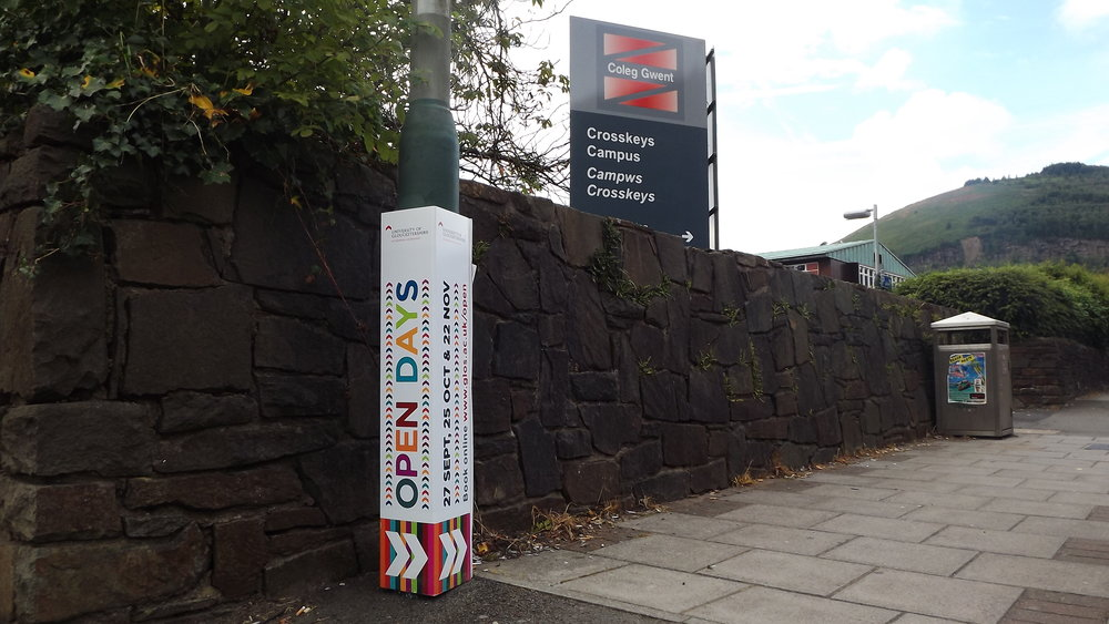 Adverticals - Excellent as either a standalone branding piece or temporary way-finding signage. Adverticals can be spread across dozens of locations on a university campus or a local area.Adverticals are custom-sized to fit virtually any lamppost, post or pillar.