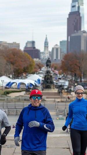 Smiling on Rocky Steps. See Philly Run.