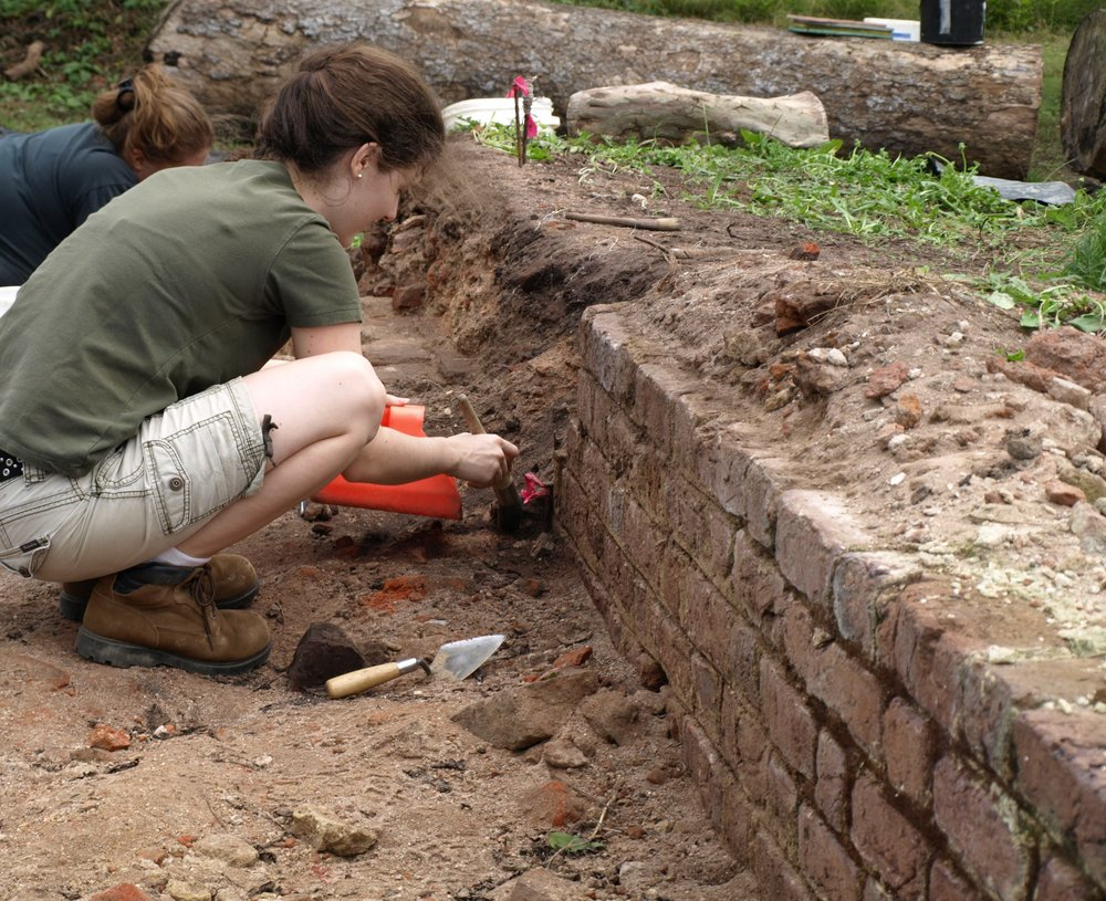 Students cleaning foundation bricks.JPG