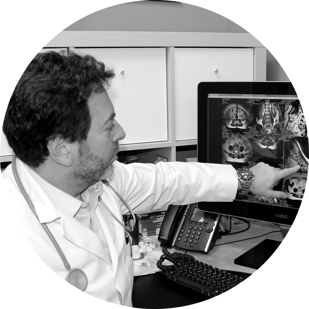 an-accurate-diagnosis_doctor-pointing-to-explaining-xrays-to-patient_chiropractic-neurology_functional-medicine_b&w.png