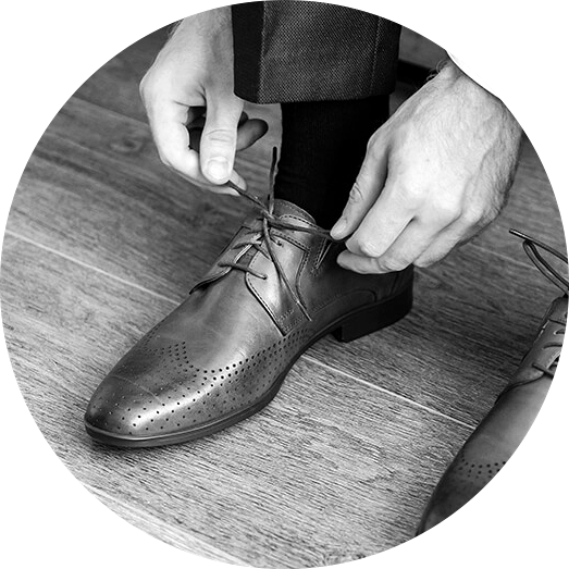 orthotics_insoles_man-putting-on-shoes_tying-laces_integrated-brain-and-spine-center-for-functional-neurology-and-medicine_treatment-b&w.png