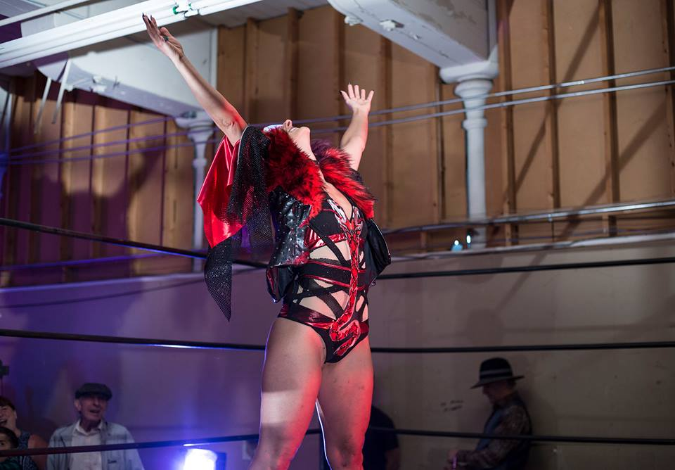 Kitty Von Strausser enters the ring in bodysuit and Rick Flair inspired coat.