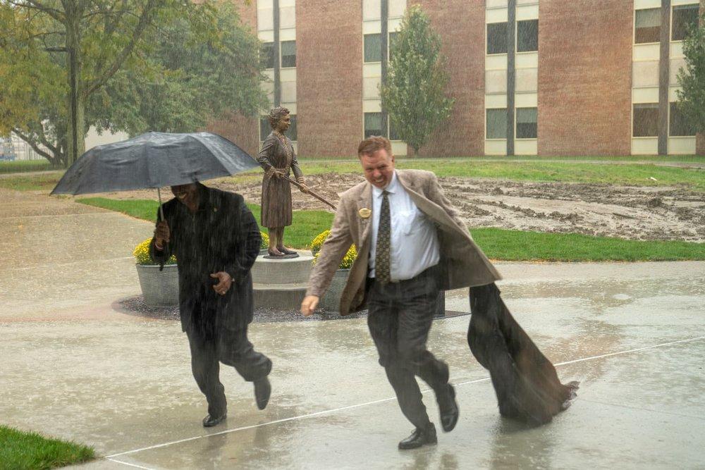 Matilda Wilson statue unveiled in the rain by Oakland University Vice President Michael J. Westfall and Chief Diversity Officer Glenn McIntosh