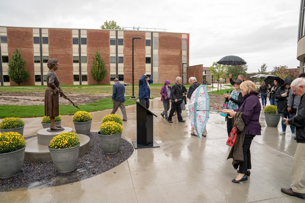 Attendees of the unveiling looking at Matilda Wilson statue