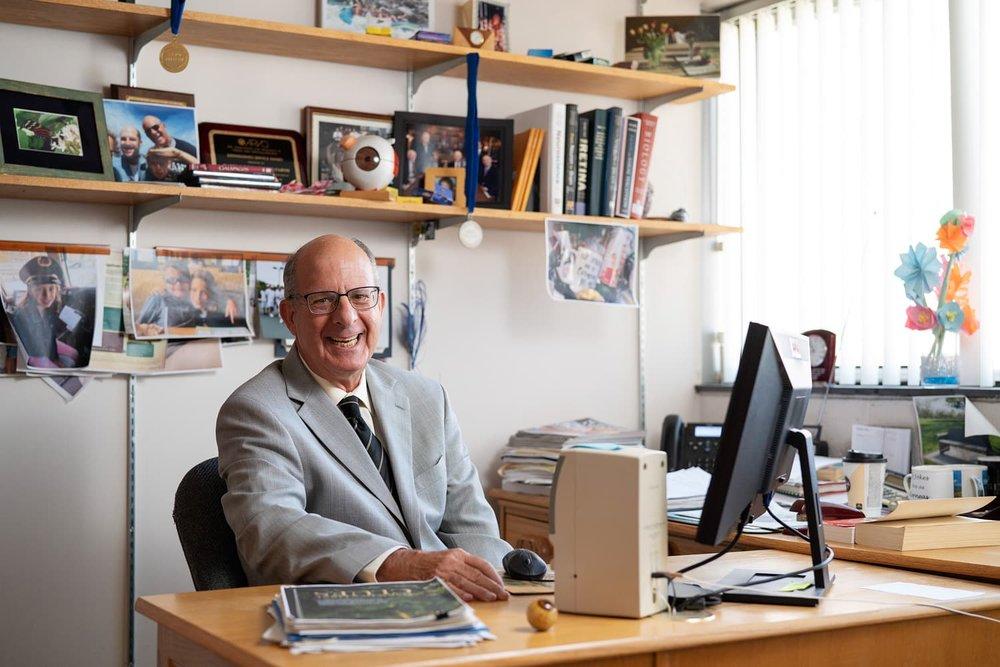 Doctor Barry Winkler smiling at desk in office