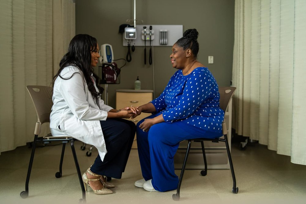 nurse practitioner working with patient
