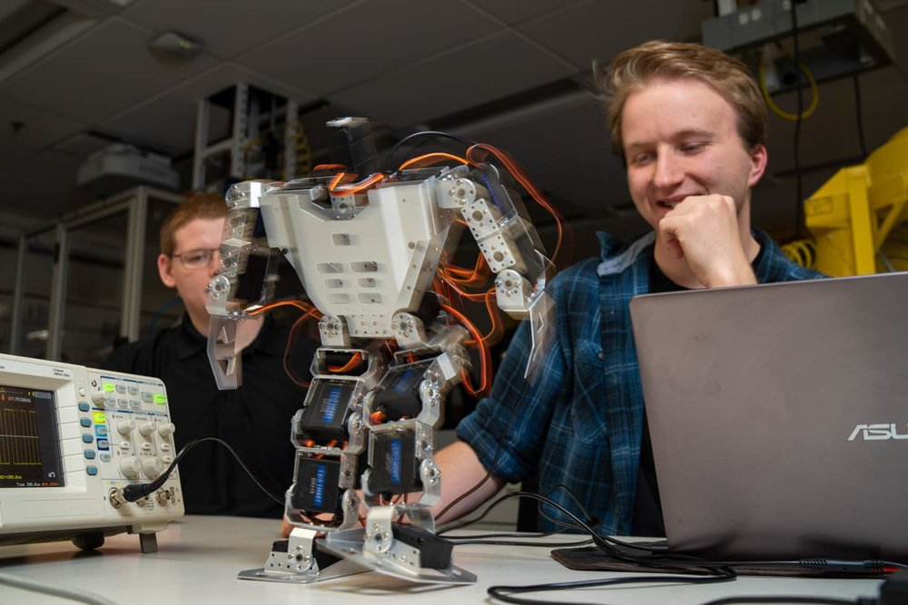 student watching walking robot