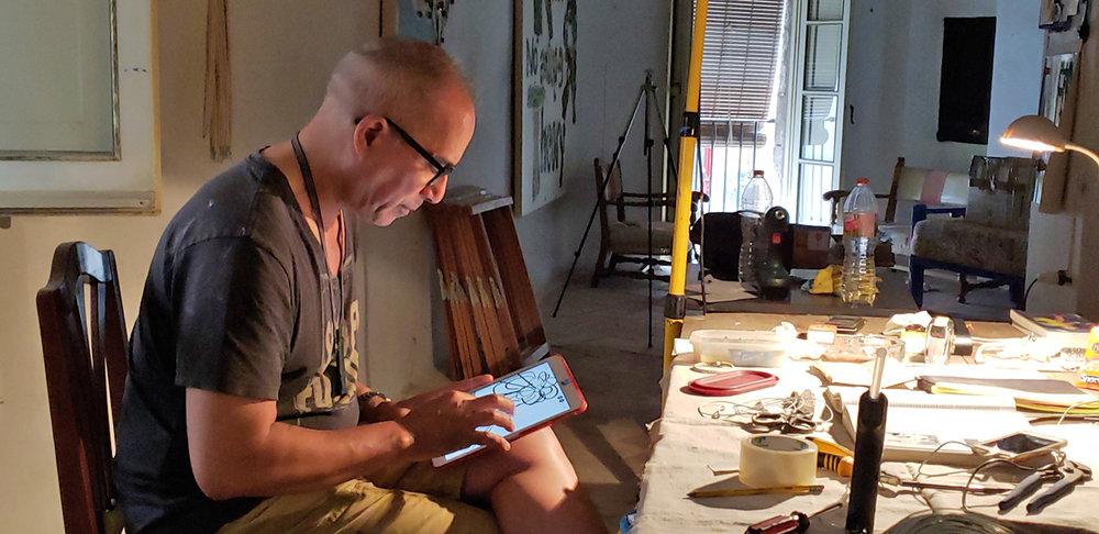 Dennis Hollingsworth at work in his Tossa de Mar studio.