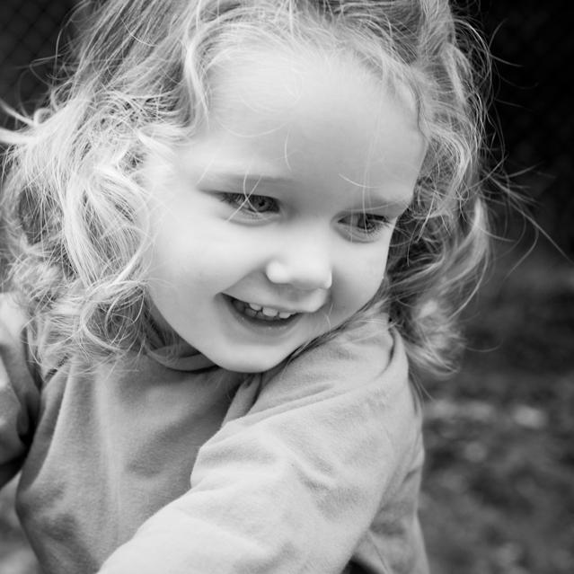 Smiling pre-school girl in black and white