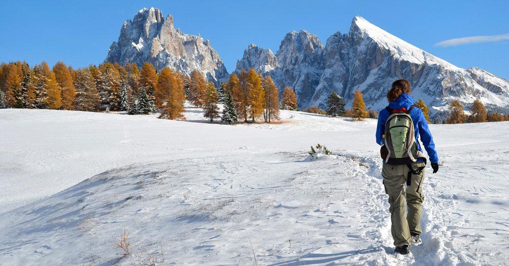 Female walker in alpine snow