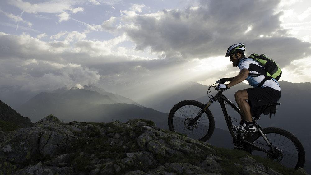 Mountain Biker Summitting