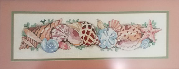 Seashells Cross-stitch done for my mother so long ago I can't remember what year.