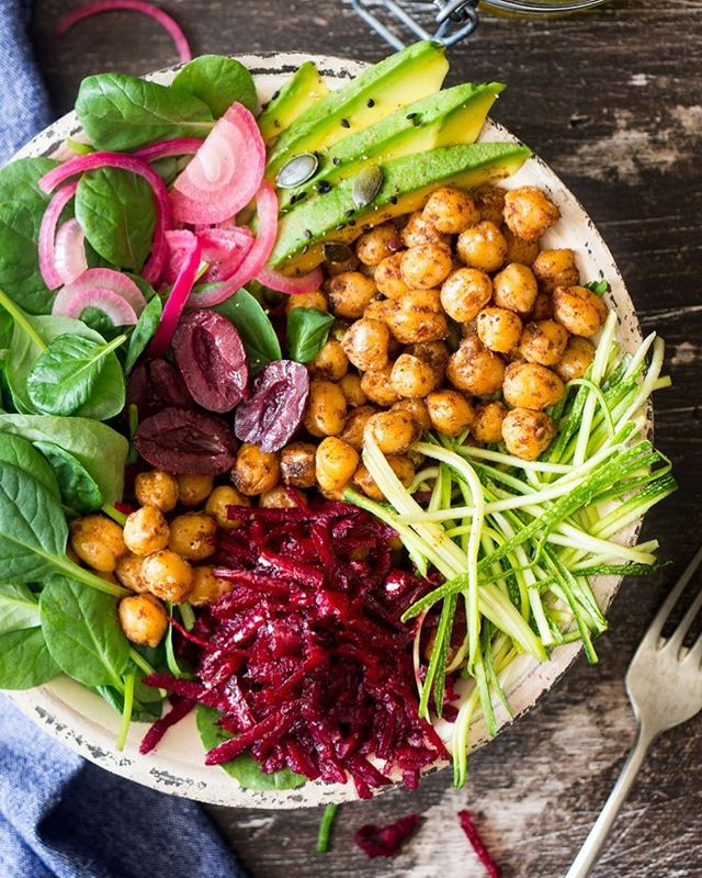 🥗👌Looks tasty, isn't it? Here is the recipe of healthy Buddha bowl for you!  CUMIN-ROASTED CHICKPEAS * 2 cups cooked chickpeas * 2 tbsp olive oil * 2 tsp ground cumin * 1 tsp smoked paprika * ½ tsp hot chilli powder * salt, to taste  BOWLS * 50 g baby spinach * 1 medium beetroot * ½ small quick-pickled red onion * ½ avocado, peeled and sliced * 6 Kalamata olives,l * 1 baby zucchini / courgette, shredded into zoodles * 1 tbsp pumpkin seeds / pepitas  DRESSING * 2 tbsp extra virgin olive oil * 1½ tbsp lemon juice * 1 garlic clove, unpeeled * 1 tsp sambal oelek * salt, pepper  METHOD 1. Place chickpeas in a colander for a few minutes to drain them well. If you cooked the chickpeas yourself, let them cool down completely before pan roasting them. 2. Heat up a heavy bottomed pan Pour 2 tablespoons of olive oil on the hot pan and wait a few seconds for the oil to heat up. Chuck drained chickpeas into the hot oil and place an unpeeled garlic clove in the pan. Let the garlic brown on both sides, then take it off the pan and set aside. Sprinkle chickpeas with spices and salt and stir the spices in. Keep on roasting the chickpeas until they are evenly coated in spices and the spices become fragrant. 3. Prepare the dressing by mixing olive oil, lemon juice and sambal oelek. Peel the garlic clove you roasted earlier, grate it finely and add it to the dressing. Season the dressing by adding salt and pepper to taste. 4. Divide all the bowl ingredients and roasted chickpeas between two bowls. Drizzle with the dressing.