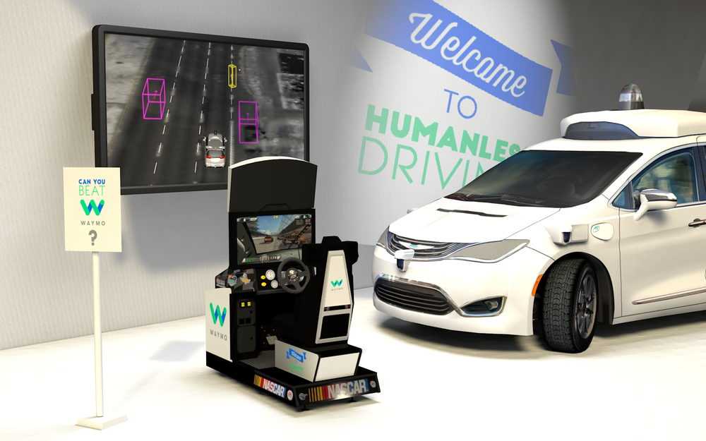 This tented activation at the Raleigh Speedway challenges participants to outdrive a Waymo self-driving car. People waiting in line are encouraged by a brand ambassador to use a tablet to add obstacles to the course, allowing the driver and the car to react in real time to hazards. Meanwhile, a screen shows a live visualization of the car's perception.